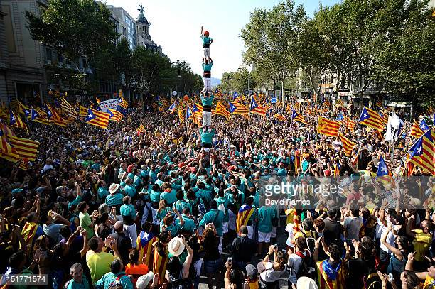 A 'Colla' build a human tower or 'Csastell' during a demonstratacion calling for independence during the Catalonia's National Day on September 11...
