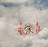 Collage of business people's faces in crystal ball in clouds