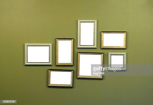 Collage of empty picture frames hanging on wall