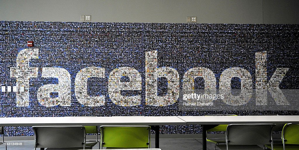 A collage of profile pictures makes up a wall in the break room at the new Facebook Data Center on April 19, 2012 in Forest City, North Carolina. The company began construction on the facility in November 2010 and went live today, serving the 845 million Facebook users worldwide.