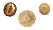 Collage of several straw hats of different shapes, isolated on white background, close-up.