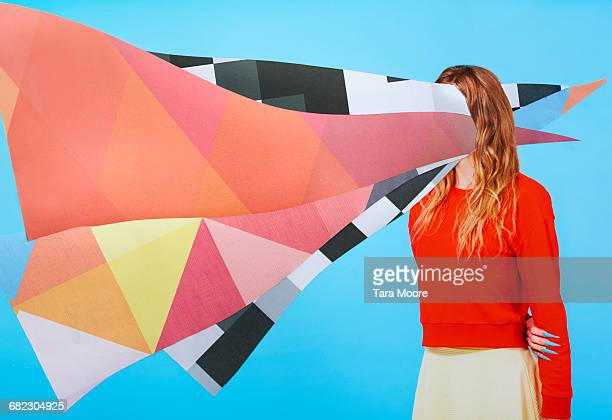 collage of woman with paper on head