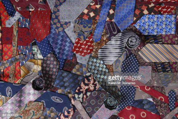 A collage / variety of men's neckties w/ 3 rolled ties
