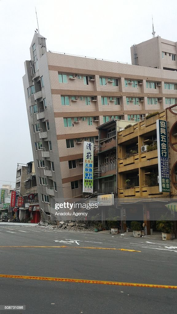 A collapsed building is seen in Xinhua District of Tainan after a powerful tremor struck souther Taiwan on February 6, 2016. At least 13 people including a baby girl were confirmed dead Saturday after a magnitude 6.4 earthquake hit southern Taiwan, collapsing buildings and injuring hundreds of others.