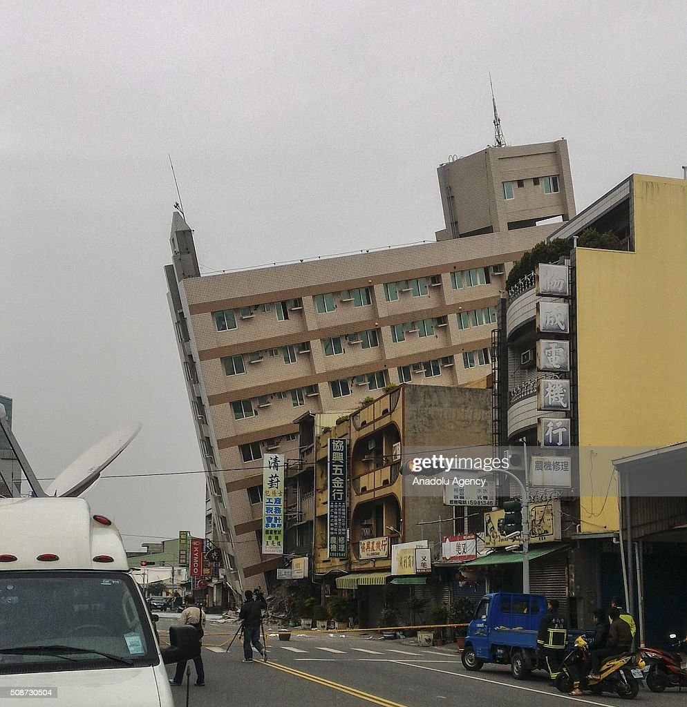 http://media.gettyimages.com/photos/collapsed-building-is-seen-in-xinhua-district-of-tainan-following-a-picture-id508730504