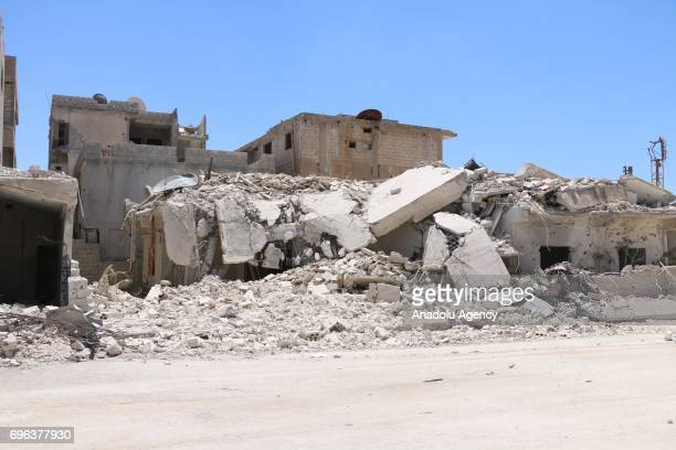 Collapsed buildings are seen after Assad regime's barrel bomb airstrike over residential areas in Daraa Syria on June 15 2017 At least 1 civilian...