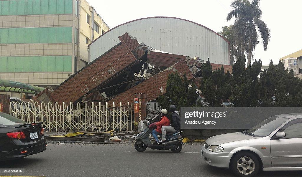 A collapsed factory in Rende District is seen on February 6, 2016 following a strong earthquake struck Taiwan. At least 13 people including a baby girl were confirmed dead Saturday after a magnitude 6.4 earthquake hit southern Taiwan, collapsing buildings and injuring hundreds of others.
