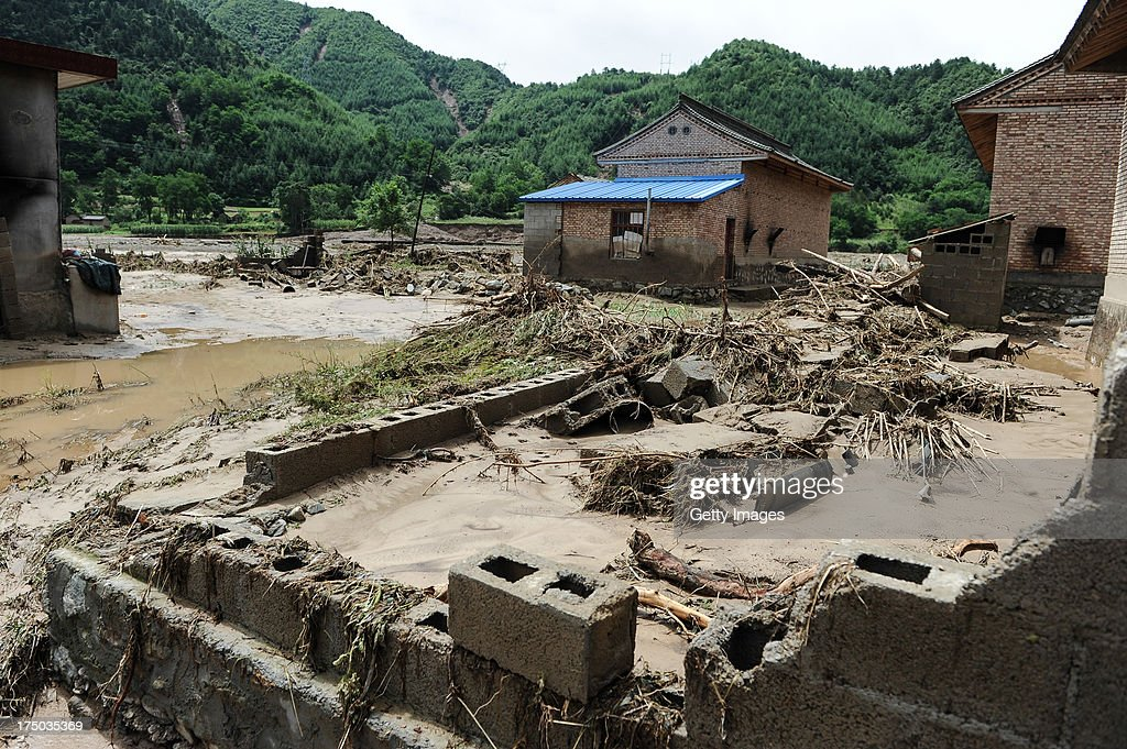 A collapsed house is seen on July 29, 2013 in Tianshui, China. At least 24 people were killed, with one person still missing, after rainstorm-triggered floods and landslides hit many areas of Tianshui city recently.