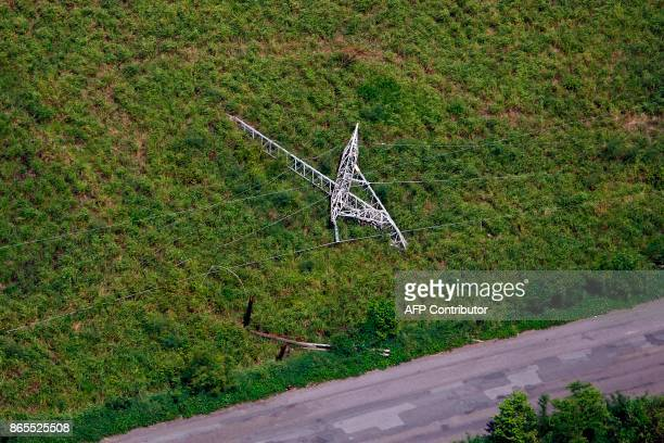 A collapsed power line tower is seen after the passing of Hurricane Maria in Naguabo Puerto Rico on October 23 2017 The US House of Representatives...