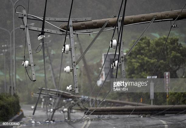 TOPSHOT Collapsed power lines partially block the road as super typhoon Meranti skirts Pingtung county in southern Taiwan on September 14 2016 Parts...