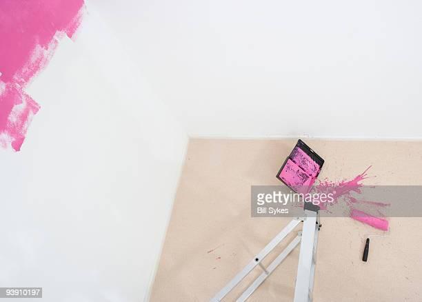 collapsed stepladder and spilt paint