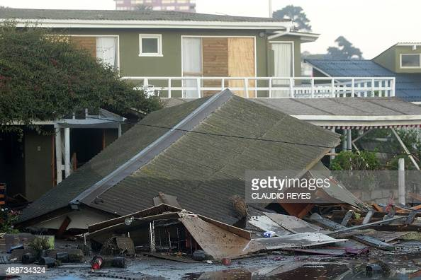 A collapsed structure in Concon some 110 km northwest of Santiago on September 17 2015 hit by an earthquake on the eve A powerful 83magnitude...