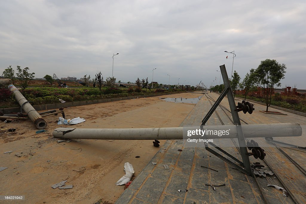 A collapsed telegraph pole lies on the ground on March 20, 2013 in Daoxian, China. Three people have been killed and about 50 others injured after a tornado struck Central China's Hunan Province early on Wednesday morning.