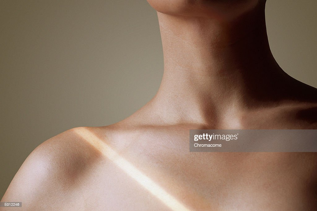 Collarbone of woman with light stripe : Stock Photo