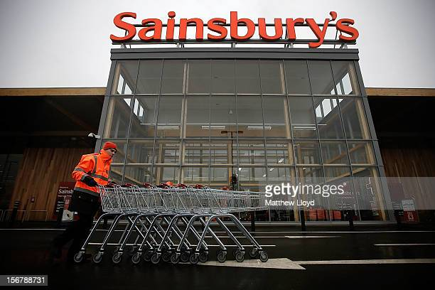 A colleague moves trolleys in the car park of Sainsbury's new Kings Lynn supermarket one of the retailer's most energy efficient stores on 21...