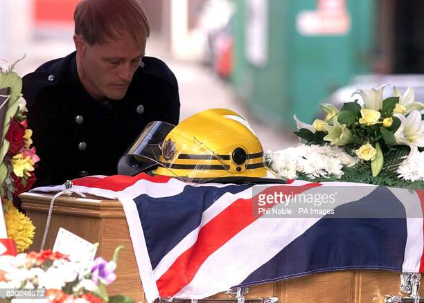 A colleague of firefighter Paul Metcalf prepares to carry his coffin into Bury parish church Greater Manchester Metcalf died whilst trying to rescue...