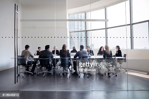 Colleagues at business meeting in conference room : Stock Photo