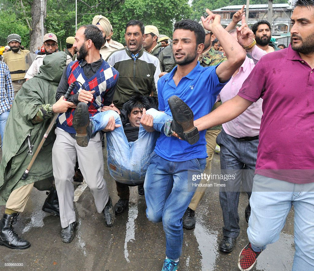 Colleagues carry an injured Public Health Engineering department (PHE) government employee during a protest on May 24, 2016 in Srinagar, India. Police detained dozens of government employees, and resorted to baton charging to disperse the employees during the protest march. The government employees demanded the regularization of contractual jobs and release of salaries.