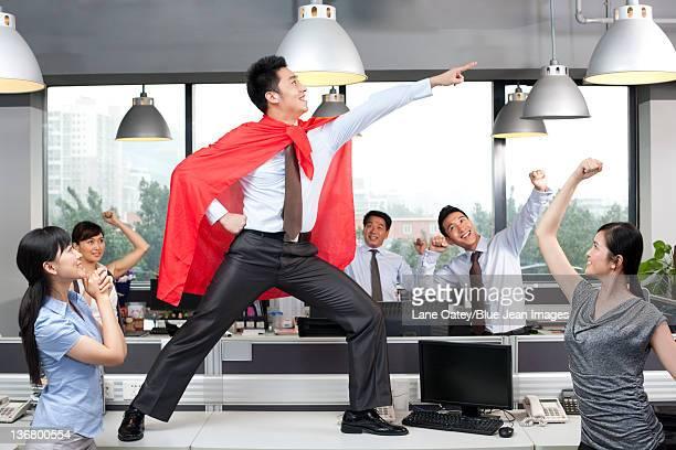 Colleagues Cheering On Superhero