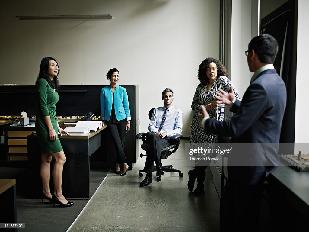 Colleagues discussing project in informal meeting : Stock Photo