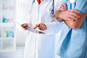 colleagues doctors discusses findings from the patient's card