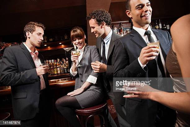 Colleagues drinking together in bar