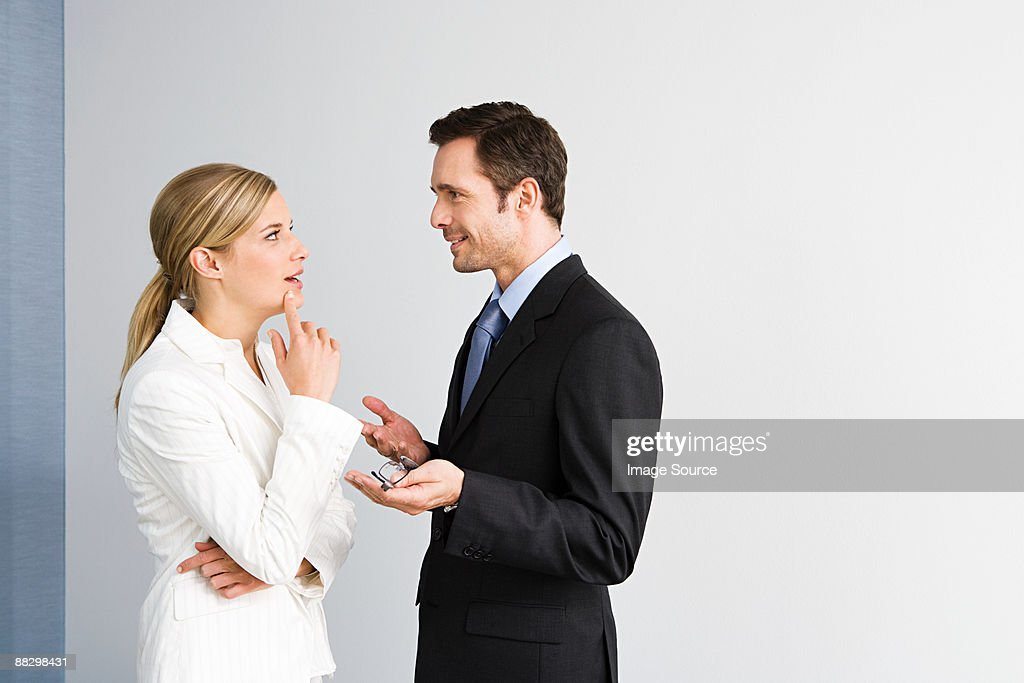 Colleagues having discussion : Stock Photo
