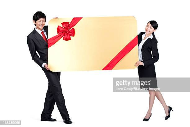 Colleagues Holding an Oversized Wrapped Card