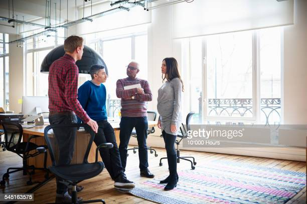 Colleagues in an informal meeting in modern office