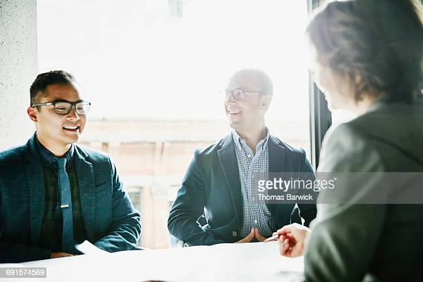 Colleagues in discussion during informal meeting