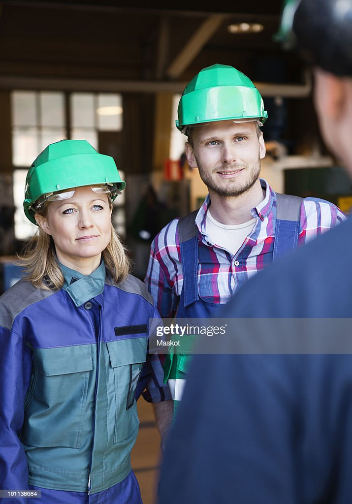 Colleagues in industrial environment : Stock Photo
