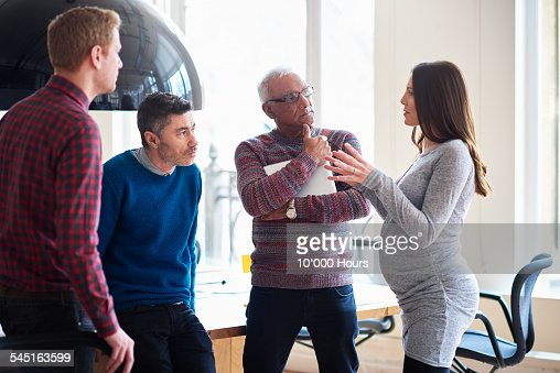 Colleagues in informal meeting in a modern office