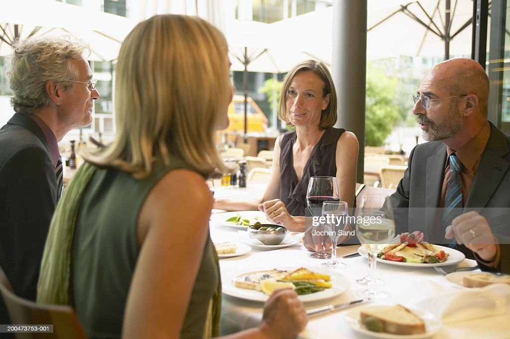 Colleagues in restaurant having business lunch : Stock Photo