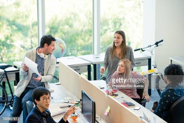 Colleagues interacting in casual office