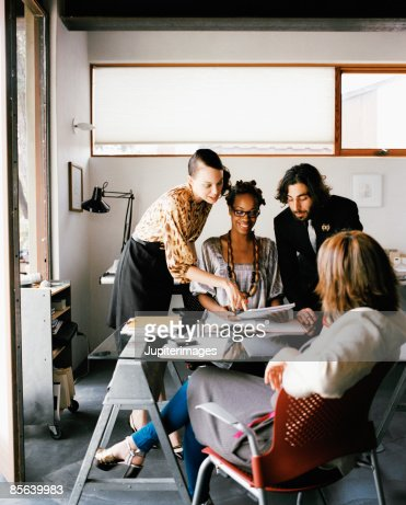 Colleagues meeting in modern office : Stock Photo