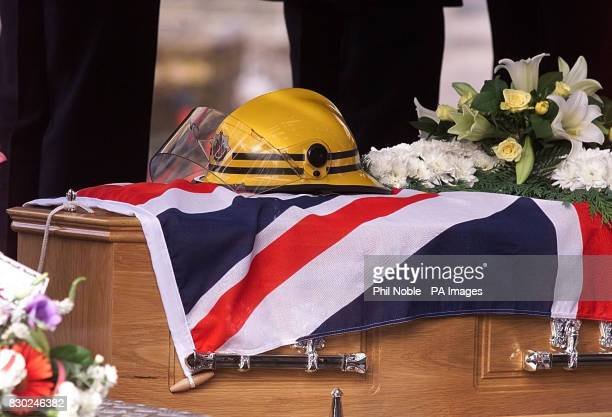 Colleagues of fire officer Peter Metcalf line the streets outside Bury Parish church as his coffin arrives on the back of a turntable ladder Metcalf...