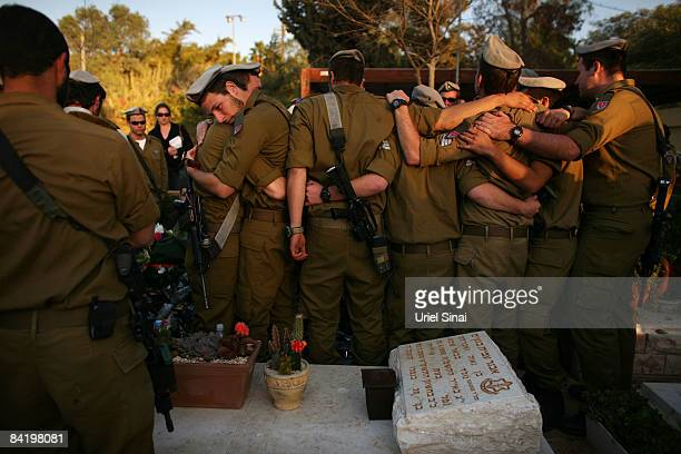 Colleagues of Israeli army Staff Sgt Alex Mashavisky who died during combat in Gaza mourn over his grave during his funeral on January 07 2009 in...