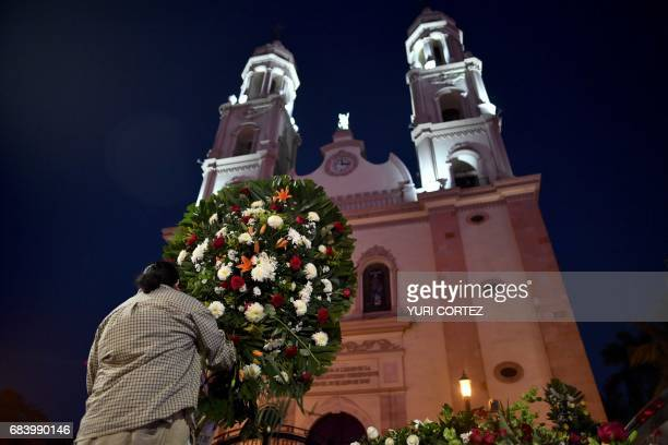 Colleagues of slain Mexican journalist Javier Valdez place flowerss at the main cathedral in Culiacan Sinaloa State Mexico following his funeral on...