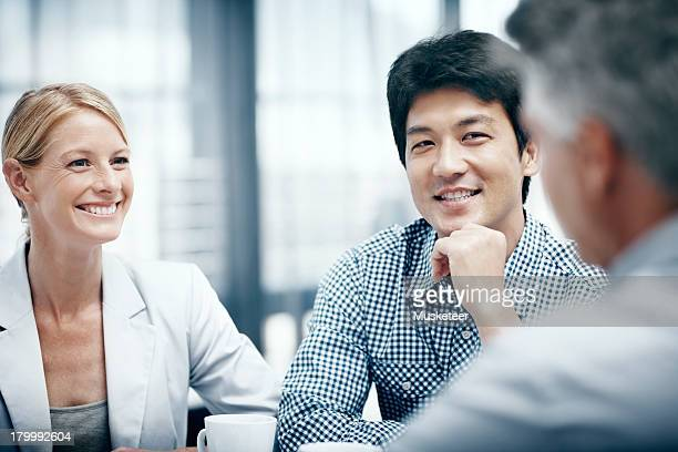 Colleagues smiling in a meeting