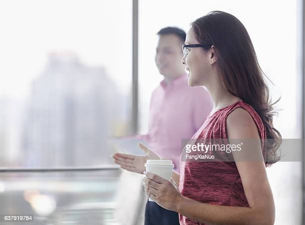 Colleagues talking in office meeting