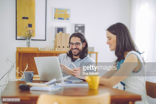 colleagues working at home office stock photo