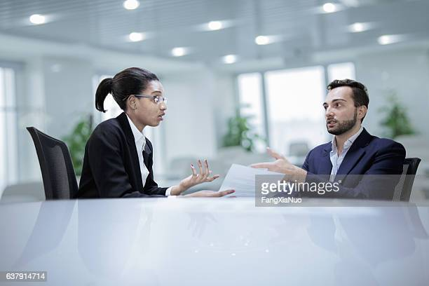 Colleagues working together during discussion in office