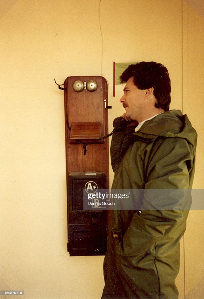 CONTENT] Colleaque making a call from the local phone box in Stanley.