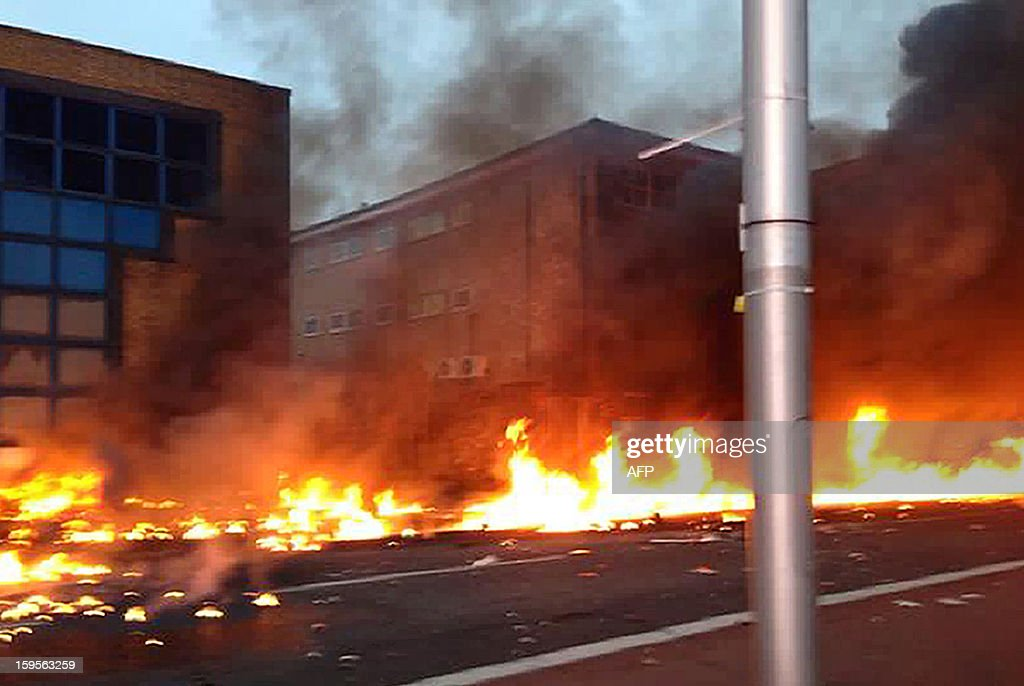 A collect picture taken by a member of the public shows flames on a road following the crash of a helicopter in central London, on January 16, 2013. Two people were killed when a helicopter hit a crane at a building site in central London and plunged to the ground on Wednesday, police said.