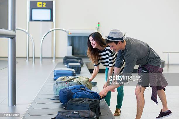 Collecting luggage at baggage terminal
