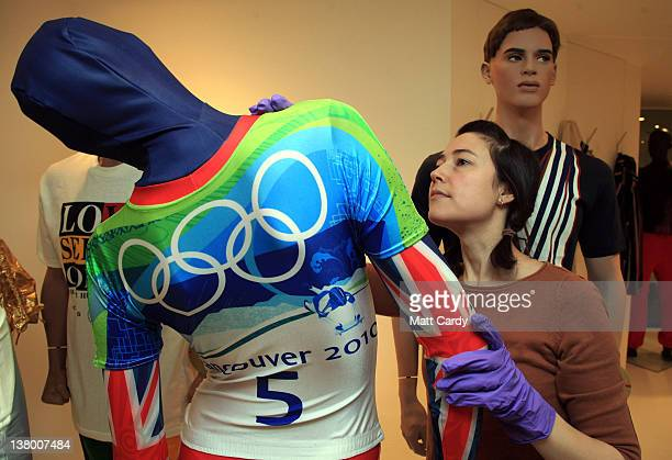 Collection assistant Elly Summers makes last adjustments to a mannequin wearing skeleton gold medalwinning Amy Williams' race suit she wore at the...