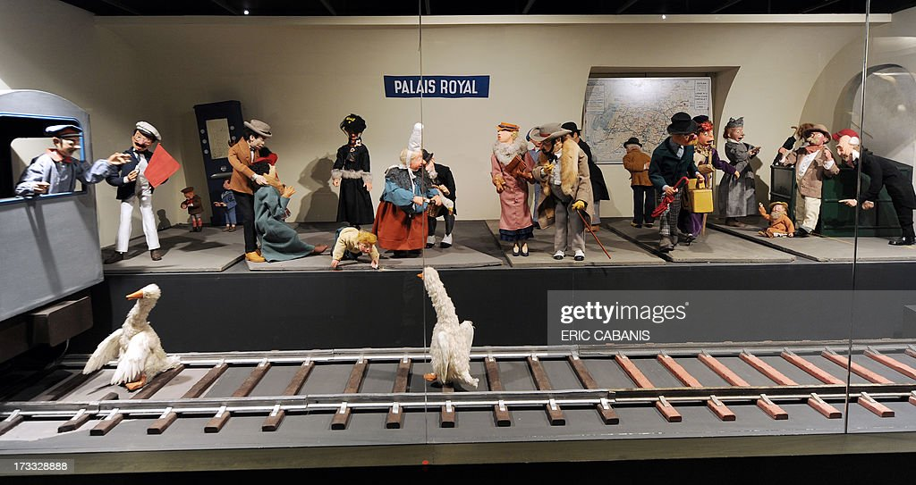 A collection from an exhibtion of 19th and 20th century automated toys depicts a Parisian metro station, presented at the Automaton Museum in Souillac on July 10, 2013. AFP PHOTO/ERIC CABANIS