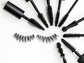collection of a mascara brushes on white background arranged in a circle with false eyelashes