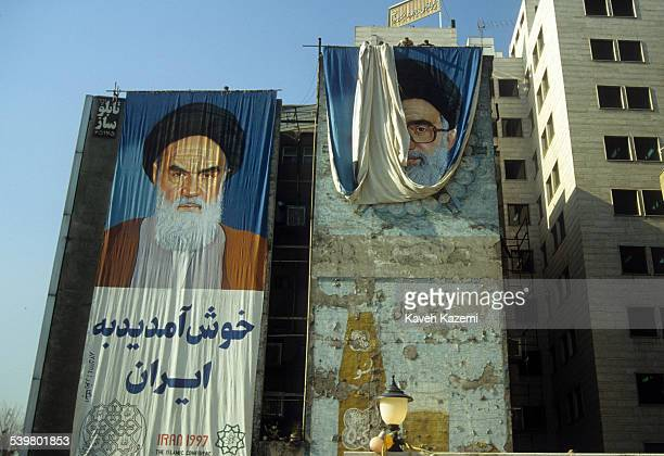 A collection of art work in the form of murals billboards banners and posters intended for propaganda purposes Photographed on the streets of Tehran...