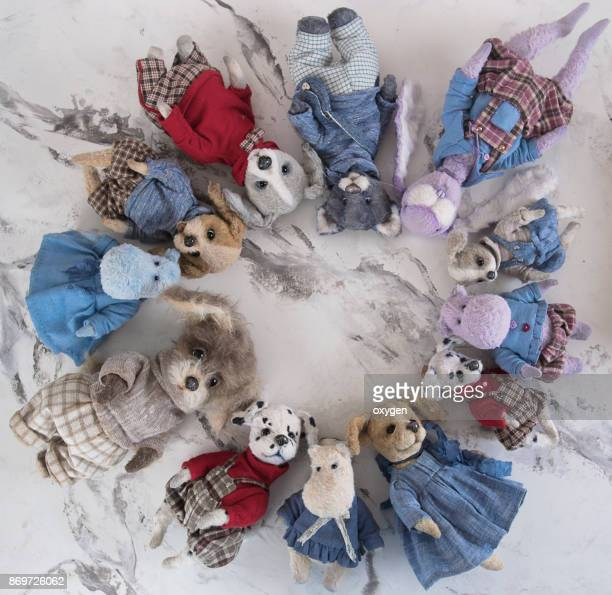 Collection of artistic teddy tos on marble gray table